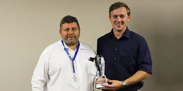 Franco Megannon, MineRP accepting Partner of the Year 2016 Award from Jacques Wessels, CEO FlowCentric Technologies